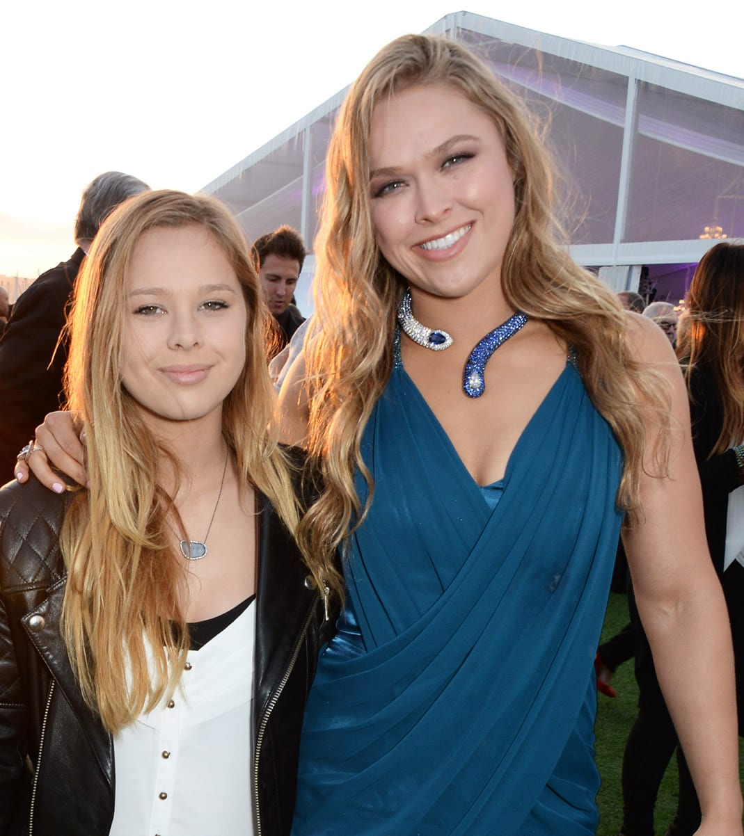 """CANNES, FRANCE - MAY 18: Ronda Rousey (R) and sister Julia Rousey attend """"The Expendables 3"""" private dinner and party at Gotha Night Club at Palm Beach on May 18, 2014 in Cannes, France. (Photo by David M. Benett/Getty Images for Millennium Films)"""